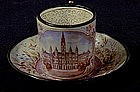 A Viennese Enamel Miniature Cup and Saucer