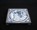 Arts & Crafts trivet: a Minton�s tile by John Moyr Smith