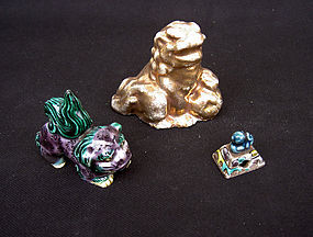 Group of three antique Shishi knobs