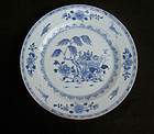 Blue and white Qianlong plate with a laid table