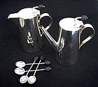 Silver plated pots or jugs by Christopher Dresser