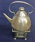 Jugendstil brass teapot & a Jan Eisenlöffel burner, c 1900-1910
