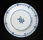 Chinese blue and white plate with a single flower, Kangxi or Yongzheng