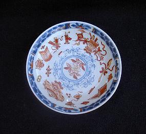 Kangxi Imari saucer, clobbered with the Hundred Treasures