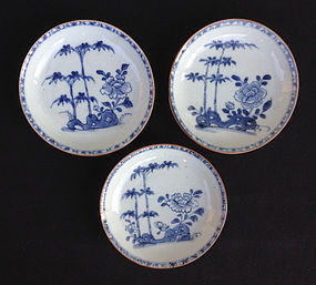 Cafe au lait or Batavia ware, three blue & white saucers, 18th century