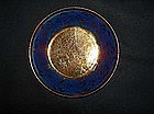 Copper lustre and blue saucer