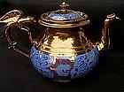 Copper lustre and blue teapot
