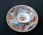 A Chinese Imari and Batavia brown tea bowl and saucer