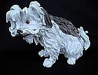 A figurine of a dog, after a Meissen model