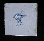 Dutch Delft tile with an angel carrying a torch