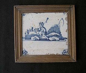 Dutch Delft tile with a small boy playing
