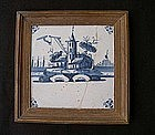 Dutch Delft tile with a church and a mill