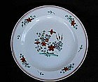 English salt-glazed plate, decorated in Holland
