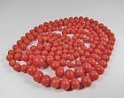 Long natural dark salmon color coral bead necklace