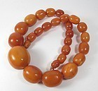 Large genuine butterscotch amber bead necklace 107.3 grams