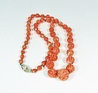 Antique, natural, carved dark salmon color coral bead necklace