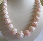 Massive carved Angel Skin Coral necklace with dragon beads