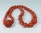 Large 14k gold natural red Momo coral bead necklace