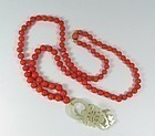 Chinese, salmon coral bead necklace white jade carved pendant
