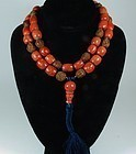 Huge, antique, Chinese coral & carved peach pit bead necklace