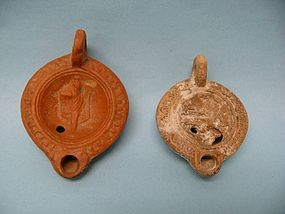 Two Roman Pottery Figural Oil Lamps
