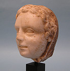 Roman Marble Head of a Goddess or Young Woman