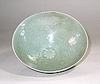 A Finely Molded Floral Decorated Celadon Bowl