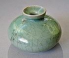 A Very Fine Sea-Green Koryo Celadon Inlaid Oil Bottle