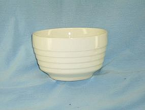 "Unmarked white pottery ""oatmeal"" bowl"