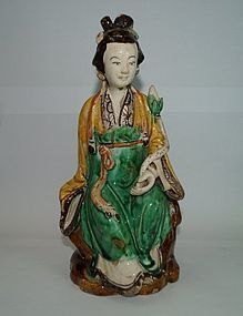 Late Ming dynasty sancai glaze figure of seated lady.