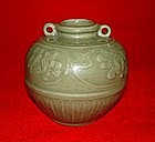 Yuan longquan celadon jar moulded flower motif