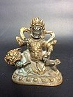 Sino Tibetan Gilded Bronze Vaishravana on a Lion 19th Century