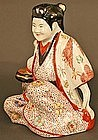 Japanese Antique Porcelain Seated Girl, 19th Century