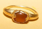 Ancient Gold Ring with a Brown Stone