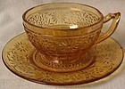 Daisy Amber Cup and Saucer Indiana Glass Company