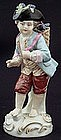 Porcelain Figure Grape Picker
