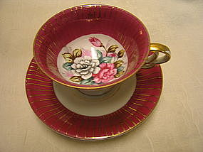 Maroon and Gold Porcelain Cup and Saucer
