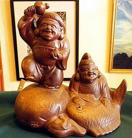 Japanese studio Bizen Okimono of happy god with fish