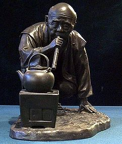 Japanese Bronze Okimono Meiji Singed making hot water