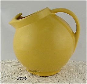 McCOY POTTERY � EARLY BALL SHAPED PITCHER / JUG (YELLOW