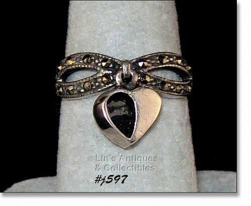 SILVER RING WITH HEART DANGLE ACCENTED WITH MARCASITES SIZE 7 1/2
