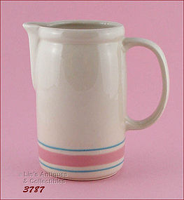 McCOY POTTERY � PINK AND BLUE PITCHER