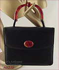 VINTAGE BLACK HANDBAG WITH FAUX TORTOISE/LUCITE HANDLE