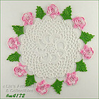3 CROCHET DOILIES WITH PINK FLOWERS AND GREEN LEAVES
