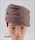 TAUPE COLOR TURBAN STYLE HAT WITH ACCENT FEATHERS