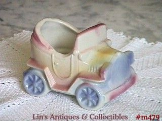 SHAWNEE POTTERY -- LITTLE CAR PLANTER (8 SPOKE)