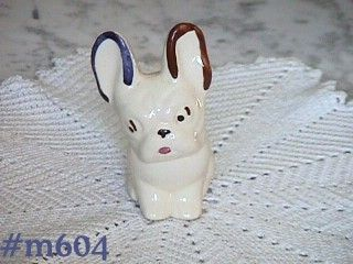 SHAWNEE POTTERY -- SMALL WHITE DOG PLANTER