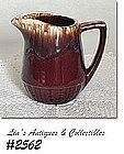 McCOY POTTERY -- BROWN DRIP CREAMER (TALL SIZE)