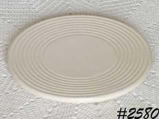 McCOY POTTERY -- WHITE TRIVET