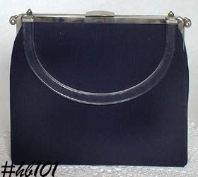 """RIGID REVERSIBLE"" HANDBAG"